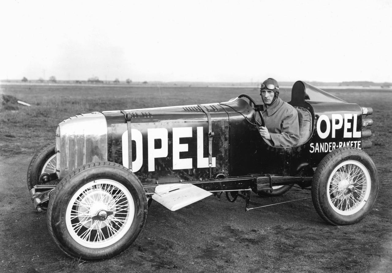 First ever rocket car: Opel RAK 1 with Opel engineer and racing driver Kurt Volkhart at the wheel.